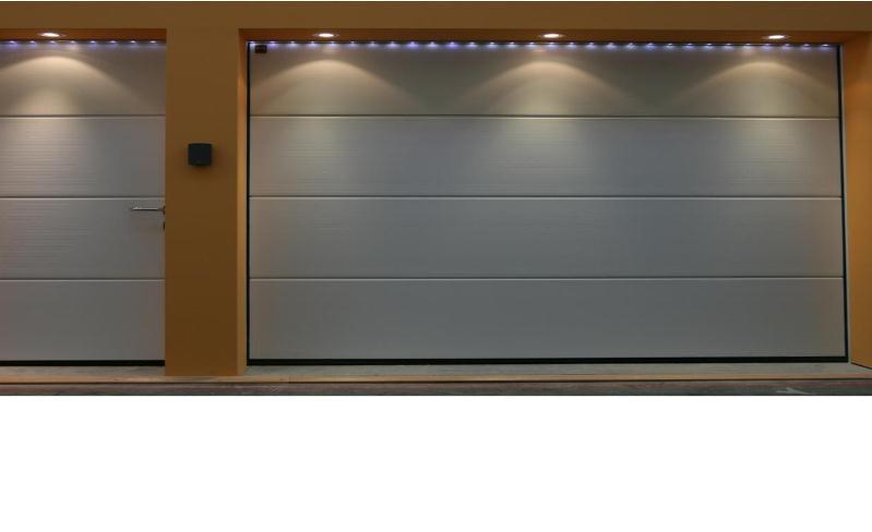 Puertas de garaje seccionales for Garajes modelos